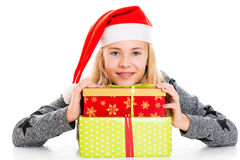 Girl with Santa- cap and present Royalty Free Stock Image