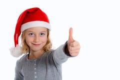 Girl with Santa- cap and thumb up Royalty Free Stock Image