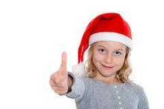 Girl with Santa- cap and thumb up Stock Photo