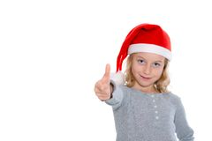 Girl with Santa- cap and thumb up Royalty Free Stock Photography