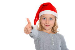 Girl with Santa- cap and thumb up Stock Images