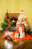 Girl and Santa Claus. Age 5 years stock photography