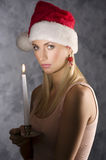 Girl santa claus with candle Stock Image