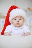 Girl in Santa Claus Cap Stock Image