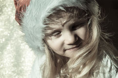 Girl with santa claus cap Royalty Free Stock Images