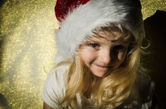 Girl with santa claus cap Royalty Free Stock Photos