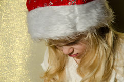 Girl with santa claus cap Stock Images