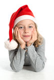 Girl with santa claus cap Stock Image