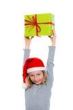 Girl with santa claus cap and present Stock Photos