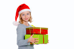 Girl with santa claus cap and present Stock Photo