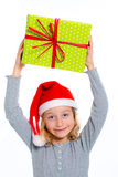 Girl with santa claus cap and present Royalty Free Stock Images