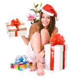 Girl Santa Claus with christmas gift box, flower. Girl Santa Claus with  christmas gift box and flower. Isolated Stock Photo
