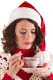 Girl in Santa Claus clothes with a cup Royalty Free Stock Photo