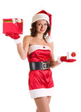 Girl in Santa Claus clothes with gifts Royalty Free Stock Image