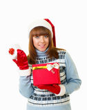 Girl in Santa Claus clothes with gifts Stock Photo