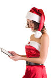 Girl in Santa Claus clothes with notebook Royalty Free Stock Images