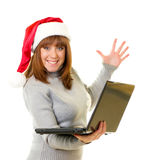 Girl in Santa Claus clothes with notebook Royalty Free Stock Photos