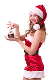 Girl in Santa Claus clothes with tasty cake Stock Photography