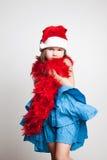 Girl in Santa Claus costume. The Girl in Santa Claus costume royalty free stock photo
