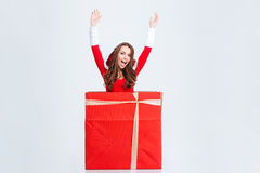 Girl in santa claus costume jumping out of present box Royalty Free Stock Photography