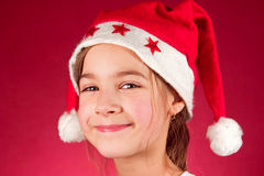 Girl and santa claus hat Stock Image