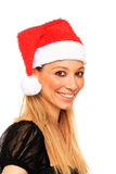 Girl with santa claus hat Stock Image