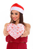 Girl with santa claus hat Royalty Free Stock Images