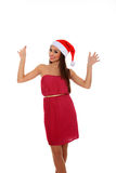 Girl with santa claus hat Stock Photos