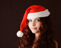 Girl in santa claus hat Royalty Free Stock Image