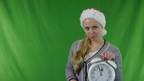 Girl  in santa claus hat with a alarm. stock video