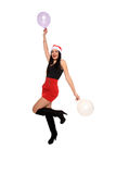 Girl with santa claus hat and balloons Royalty Free Stock Photo