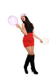 Girl with santa claus hat and balloons Stock Image