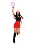 Girl with santa claus hat and balloons Royalty Free Stock Images