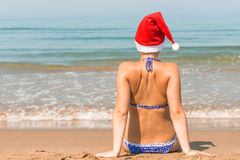 Girl in a Santa Claus hat Royalty Free Stock Photos