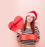 Girl in Santa Claus hat with gift box Royalty Free Stock Photo