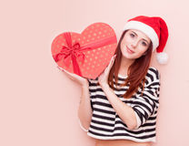 Girl in Santa Claus hat with gift box Stock Photography