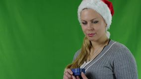 Girl in santa claus hat with gift with diamond. stock video