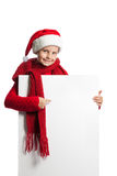 Girl in santa claus hat holding a poster Royalty Free Stock Photo