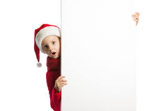 Girl in santa claus hat holding a poster Stock Image
