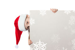 Girl in santa claus hat holding a poster Royalty Free Stock Photography