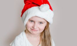 Girl in santa claus hat royalty free stock images