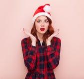 Girl in Santa Claus hat Royalty Free Stock Photos