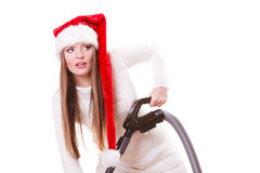 Girl santa claus hat with vacuum cleaner Stock Photo
