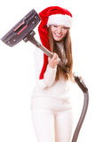 Girl santa claus hat with vacuum cleaner Royalty Free Stock Photo