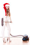 Girl santa claus hat with vacuum cleaner Royalty Free Stock Image