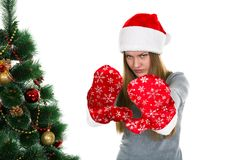 Girl in santa claus hat and winter mittens Stock Image
