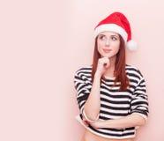 Girl in Santa Claus hat Stock Photos