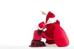 girl and Santa Claus pointing to white background Stock Images