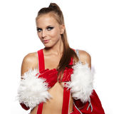 Girl in santa claus suit with gift bag over white Stock Images