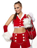 Girl in santa claus suit with gift bag over white Royalty Free Stock Photos